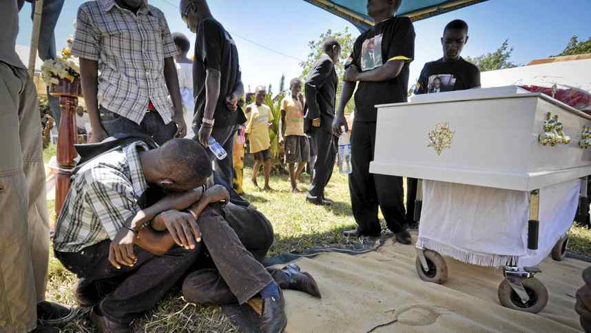 Members of the Ugandan gay community mourn at the funeral of murdured activist David Kato near Mataba, on January 28, 2011.