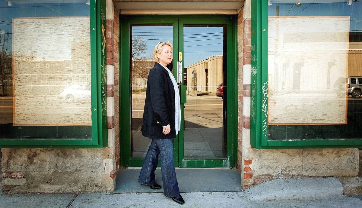 Marie Larson stands in front of her old storefront on Bathurst Street in Toronto, where she grew and sold sprouts, on April 1, 2010.