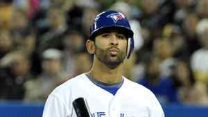 Toronto Blue Jays batter Jose Bautista catches his bat after striking out during the first inning of their MLB American League baseball game against the Texas Rangers in Toronto April 30, 2012.