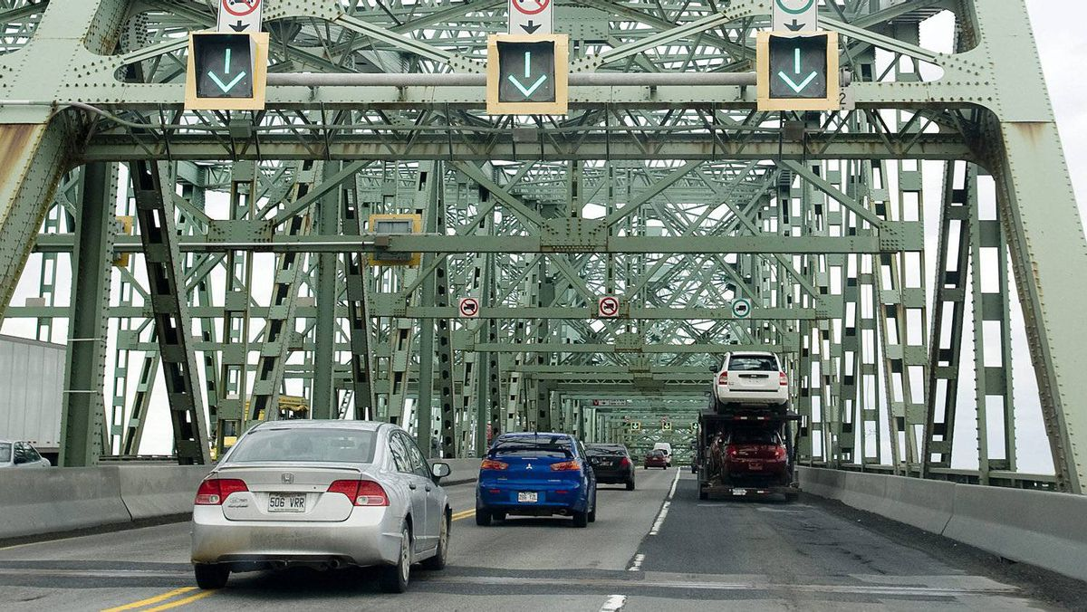 Motorists cross the Champlain Bridge in Montreal, Friday, March 18, 2011. Now Canada's busiest bridge with up to 60 million vehicles crossing per year since opening to traffic in 1961, the bridge is in need of major repair and has become a safety concern to users. (The CANADIAN PRESS/Graham Hughes)