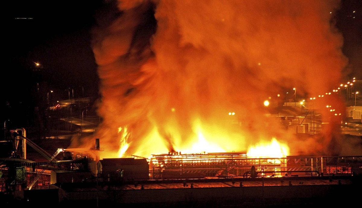A large fire burns at the Lakeland Mills sawmill in Prince George, B.C., on Tuesday April 24, 2012. An explosion rocked the sawmill just before 10 p.m. local time setting off a fire that engulfed the facility. THE CANADIAN PRESS/Andrew Johnson