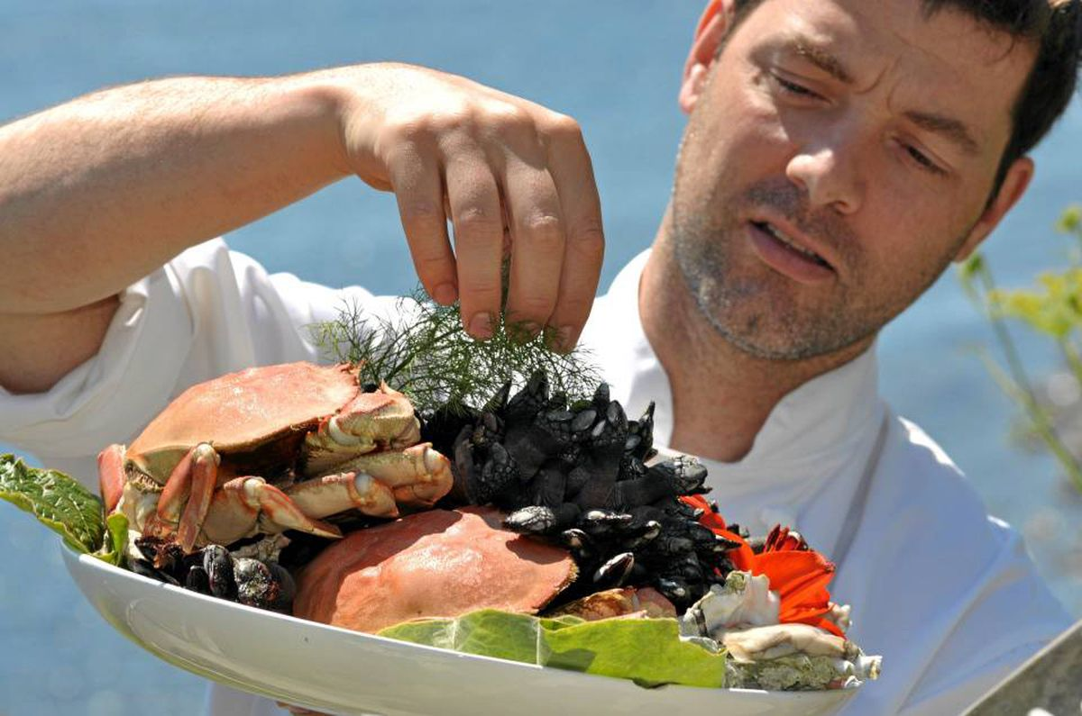 Head chef Sam Benedetto of Sooke Harbour House puts on the finishing touches on his seafood bowl full of Otter Point gooseneck barnacles, Dungeness crab and local oysters.