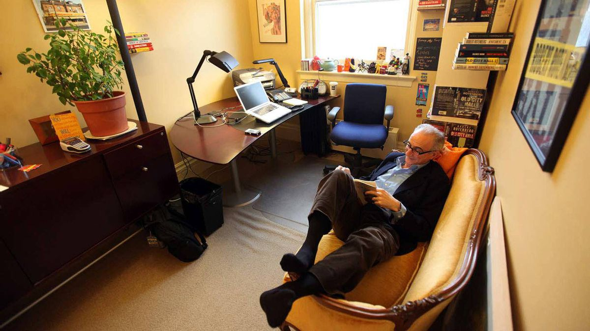 Lawyer and writer Robert Rotenberg reads on his grandmother's sofa in his downtown Toronto office.
