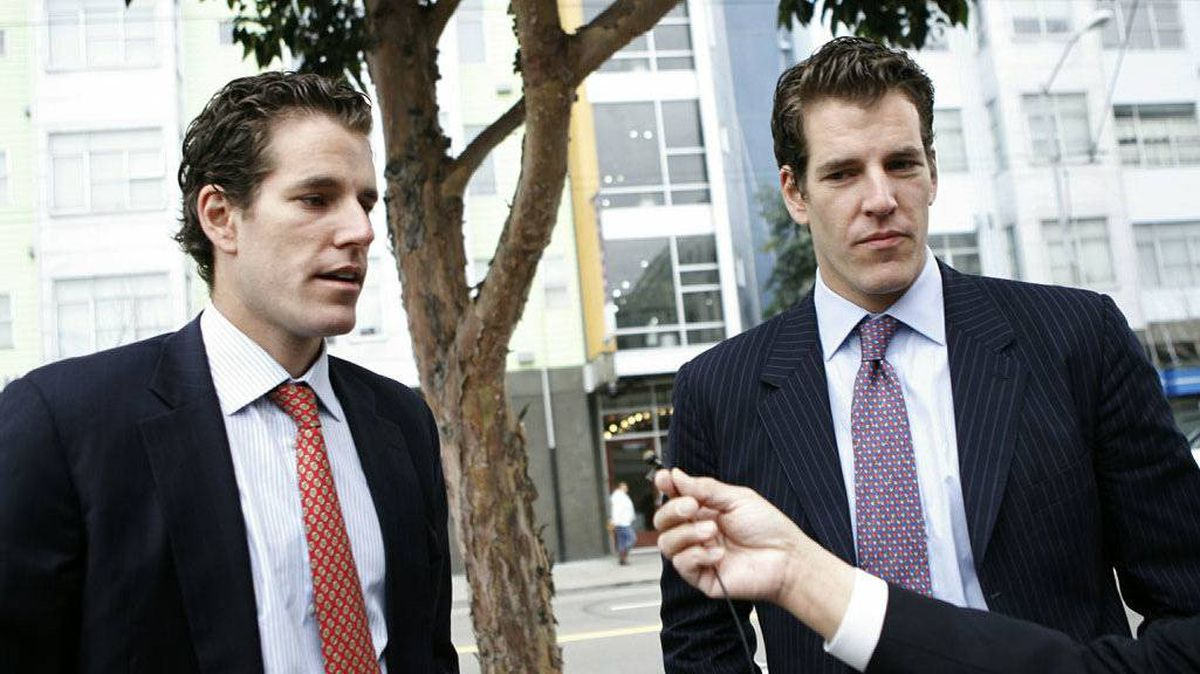 Cameron (L) and Tyler (R) Winklevoss, founders of social networking website ConnectU, speak to reporters as they leave the US Court of Appeals for the Ninth Circuit in San Francisco to attend a court hearing in a lawsuit against Facebook Inc. and its founder Mark Zuckerberg on January 11, 2011 in San Francisco.