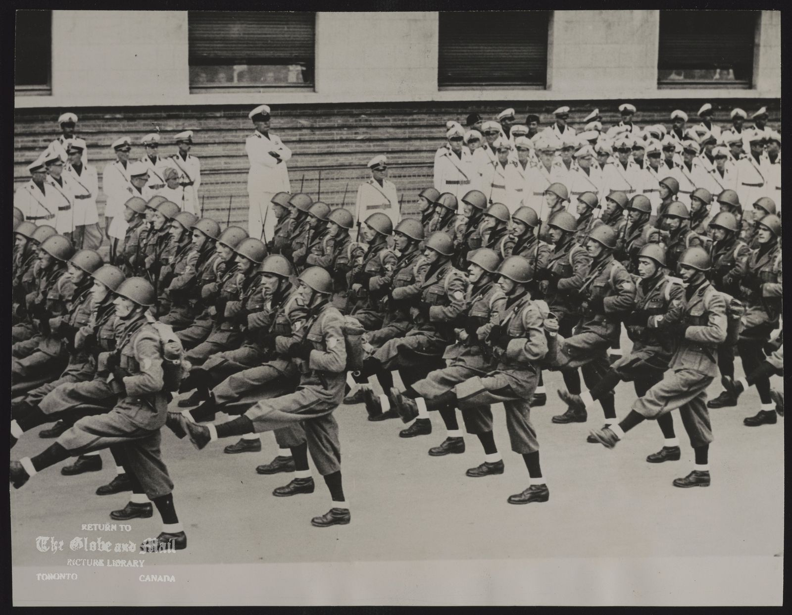 ITALY Army WIDE WORLD PHOTO : pLEASE WATCH CREDIT IL DUCE REVIEWS HIS ROMAN STEPPERS ROME.--PREMIER MUSSOLINI, WITH ARMS FOLDED, IS SHOWN WATCHING SOME OF THE FASCIST MILITIA OFFICERS MARCHING PAST IN THEIR OWN VERSION OF THE