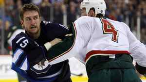 Minnesota Wild defenceman Clayton Stoner and Tanner Glass fight during the second period at MTS Center.
