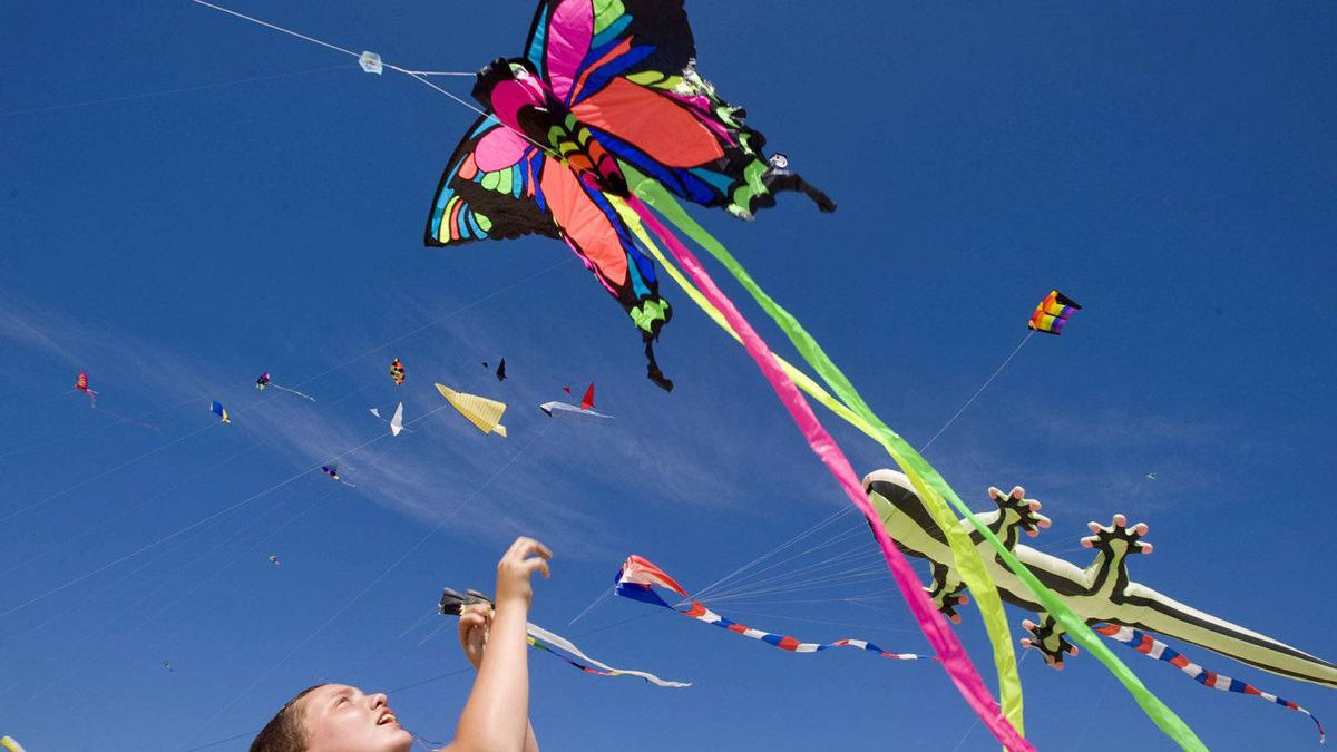 Nick Alt helps launch the family kite at the 15th annual Japan America Kite Festival in Seal Beach, Calif.