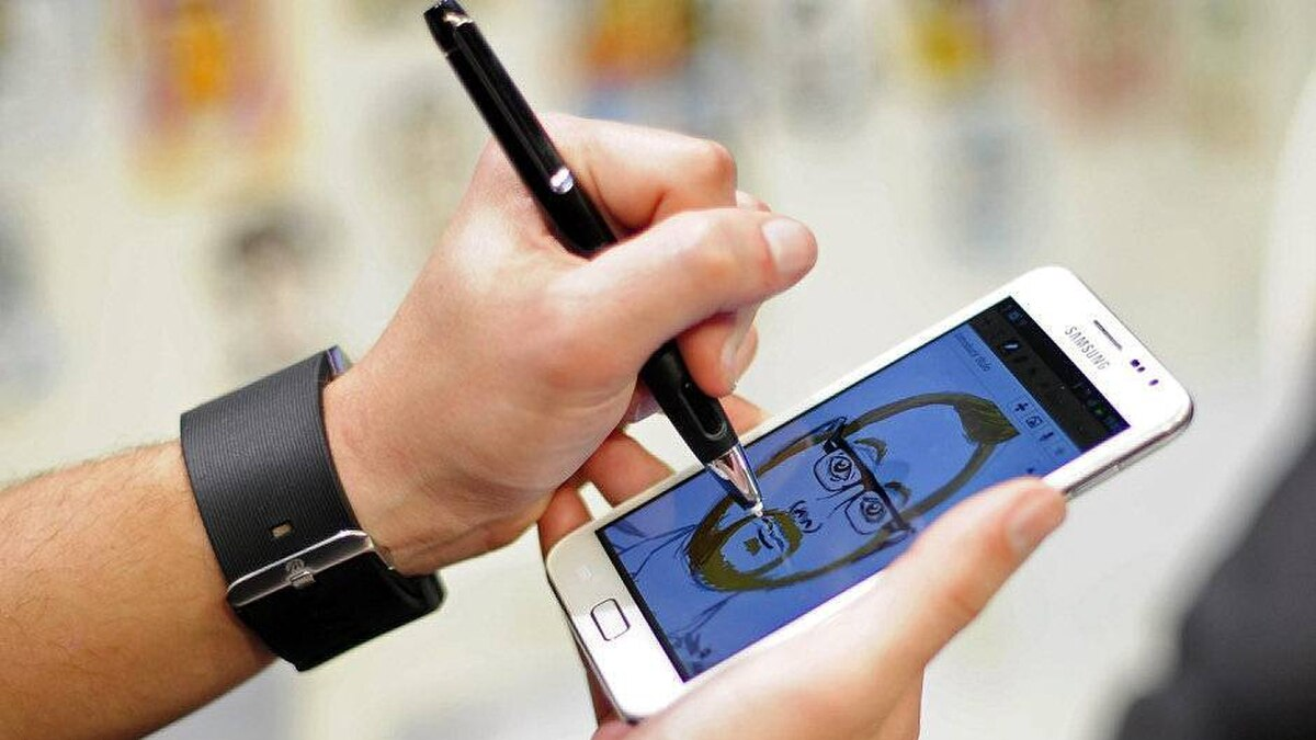 A man paints a picture in a new phone Samsung Galaxy note at the Mobile World Congress, the world's largest mobile phone trade show, in Barcelona, Spain, Monday, Feb. 27, 2012.