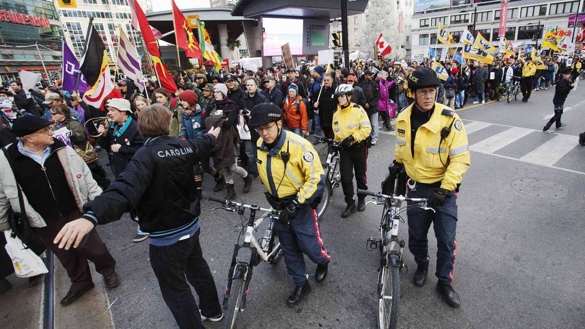 """Protesters march down Yonge Street during the """"Occupy Toronto"""" movement in Toronto Nov. 19, 2011."""