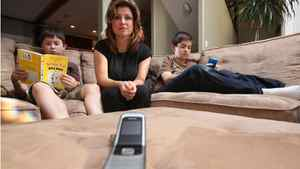 For emergency use only, sits a cell phone which Tammy Jeske gives to her kids Evan,12, left and Jaden,10, for when they're at school only to be used during bus delays, or parent pickups. Tammy has been campaigning to get phones and wi-fi out of schools.