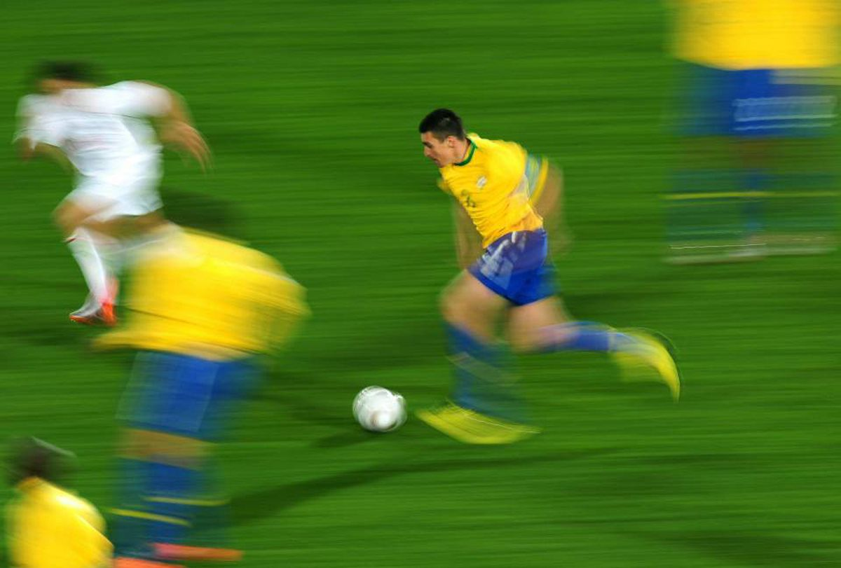 Lucio of Brazil runs with the ball during the 2010 FIFA World Cup South Africa Round of Sixteen match between Brazil and Chile at Ellis Park Stadium on June 28, 2010 in Johannesburg, South Africa.