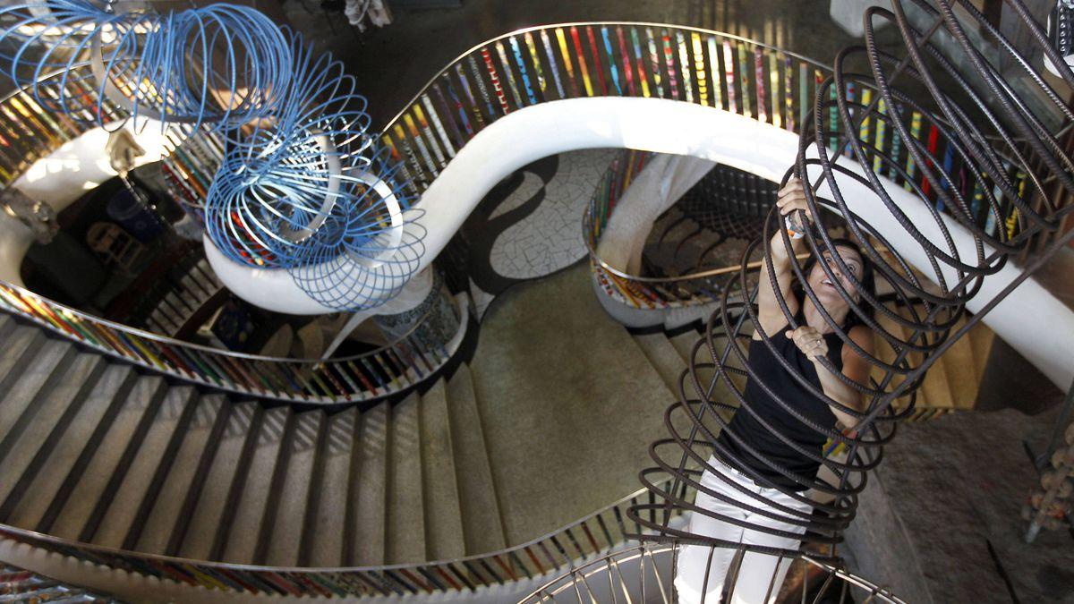 Trisha Hoss, of Seattle, climbs to the second story rather than using the stairs at City Museum in St. Louis. The City Museum is an ever-evolving art project set in an old converted shoe warehouse.