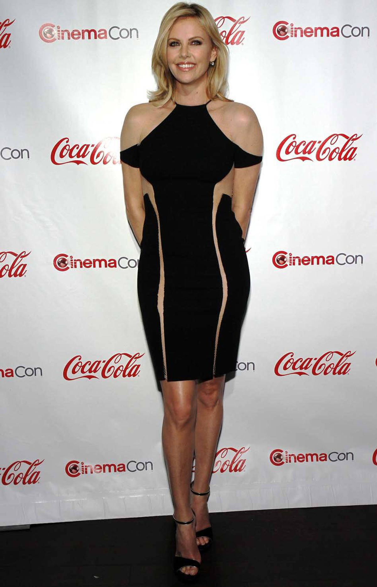 Here is Charlize Theron at the CinemaCon Big Screen Achievement Awards in Las Vegas last week wearing a theoretically impossible dress in your actually impossible dream.