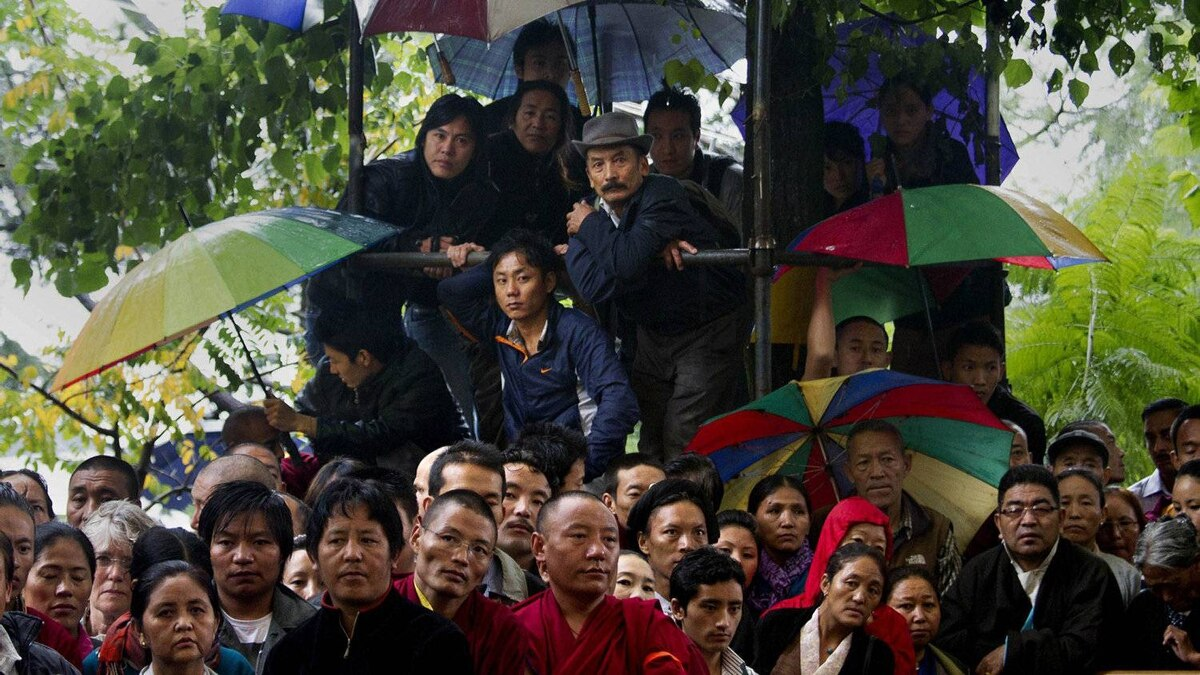 Exiled Tibetans look on during the swearing-in ceremony of Mr. Sangay. The ceremony took place in Dharmsala, India.
