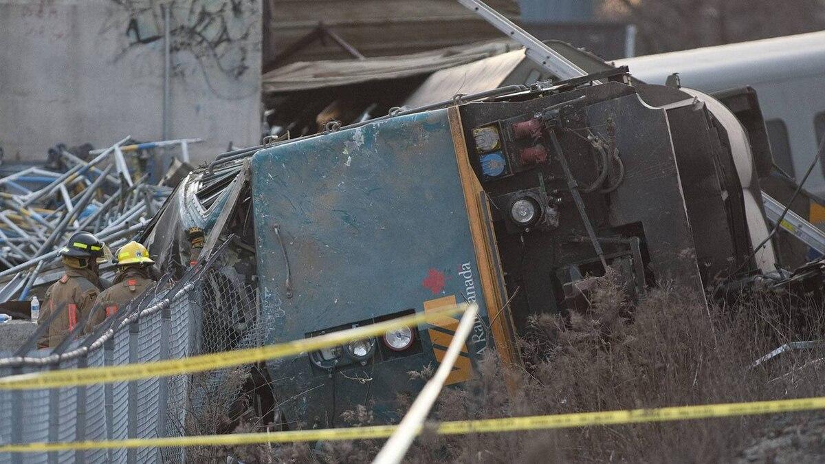 Rescue crews work on a derailed VIA rail train in Burlington, Ontario.