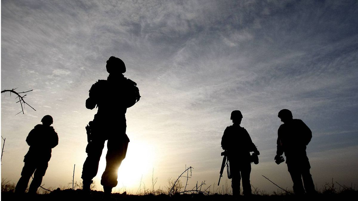 In this photo taken Tuesday, Jan. 26, 2010, Canadian soldiers from Task Force 3-09 Battle Group are seen silhouetted during operation Tazi, a village search and security operation in the Dand area of Kandahar Province, southern Afghanistan.