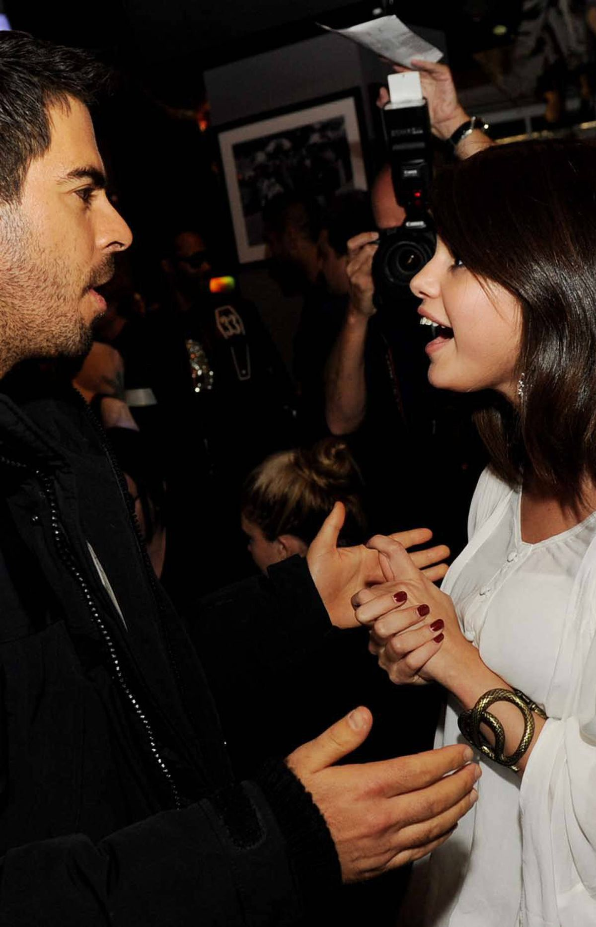 """Selena Gomez, attending the premiere of """"The Thing,"""" is delighted by Eli Roth's discourse on how power belongs to those who control the means of production You'd be good at feigning interest, too, if you were dating Justin Bieber."""
