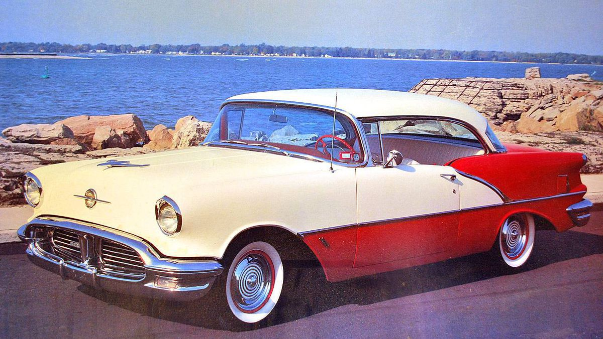 My first car was this awesome 1956 Holiday 88 Coupe Oldsmobile. It had a 3 speed standard transmission. Colour was as it is seen in the photo