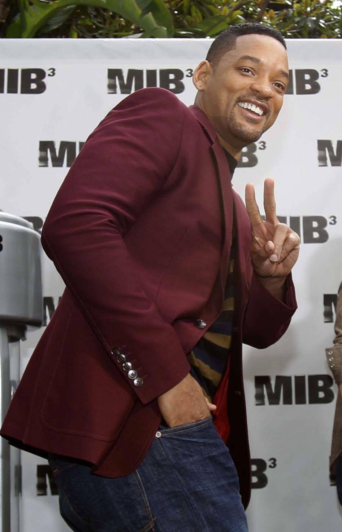 """Will Smith, desperate to save his life, actually flashes a peace sign while promoting """"Men in Black III"""" in Los Angeles last week."""