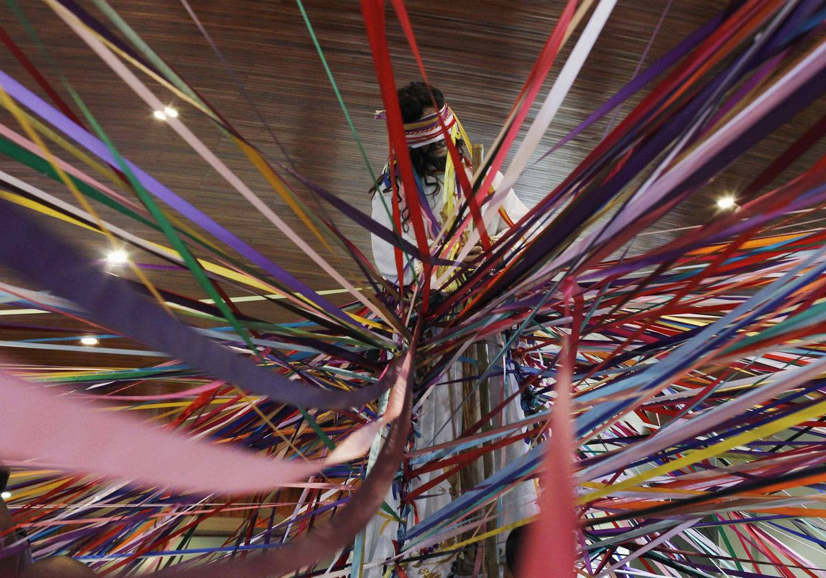 """Coloured tapes are tied to the statue of Jesus Nazareno inside the San Antonio de Padua church, before a procession known as """"Jesus Nazareno of the tapes"""", during Holy Week in Cot de Cartago, 32 km from San Jose, April 4, 2012. According Jorge Masis, a priest of the church, this procession, where people tie ribbons to the statue to symbolize promises they make to Jesus during Holy Week, is a tradition that dates back 50 years ago."""