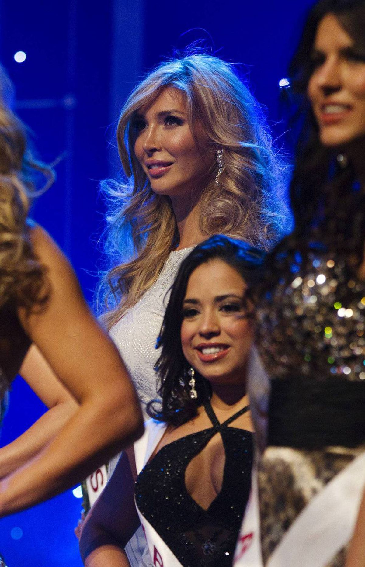 Jenna Talackova stands with other contestants at the Miss Universe Canada competition in Toronto on May 17, 2012.