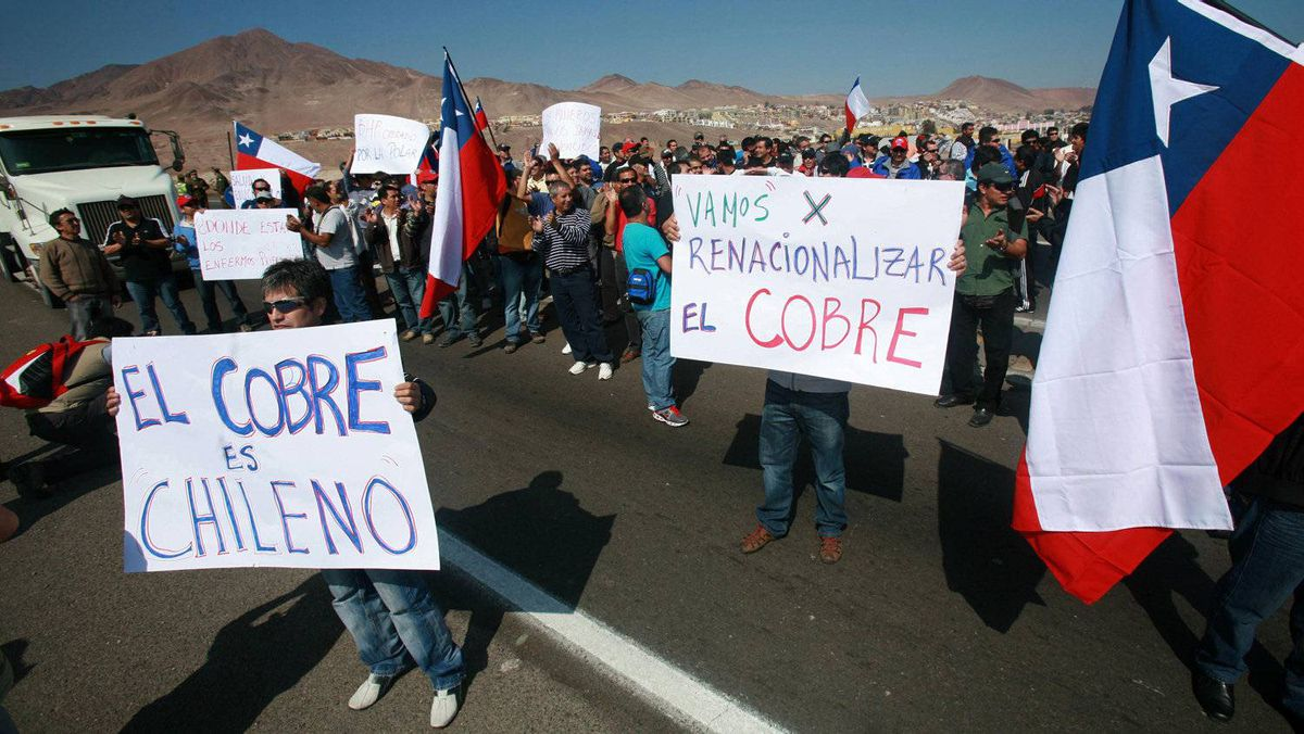 Striking copper miners at Chile's Escondida mine hold a protest.