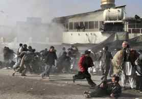 People react seconds after a suicide blast targeting a Shi'ite Muslim gathering in Kabul, Afghanistan.