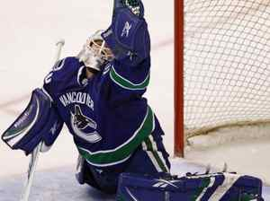 Vancouver Canucks' Andrew Raycroft makes a glove save during third period NHL action against the Anaheim Ducks in Vancouver, B.C., on Wednesday March 24, 2010. THE CANADIAN PRESS/Darryl Dyck