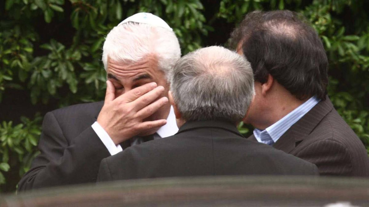 Mitch Winehouse wipes his eyes outside Golders Green Crematorium in London, Tuesday July 26, 2011, following the funeral of his daughter, singer Amy Winehouse.