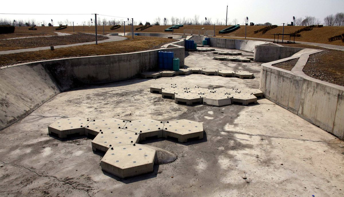The deserted and unmaintained former venue for the kayaking competition of the 2008 Beijing Olympic Games, can be seen on the outskirts of Beijing March 27, 2012.
