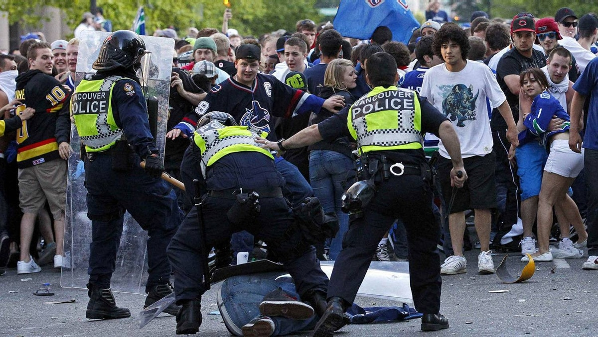 Vancouver police detain a man during riots after the Canucks lost Game 7 of the Stanley Cup Final to the Boston Bruins.
