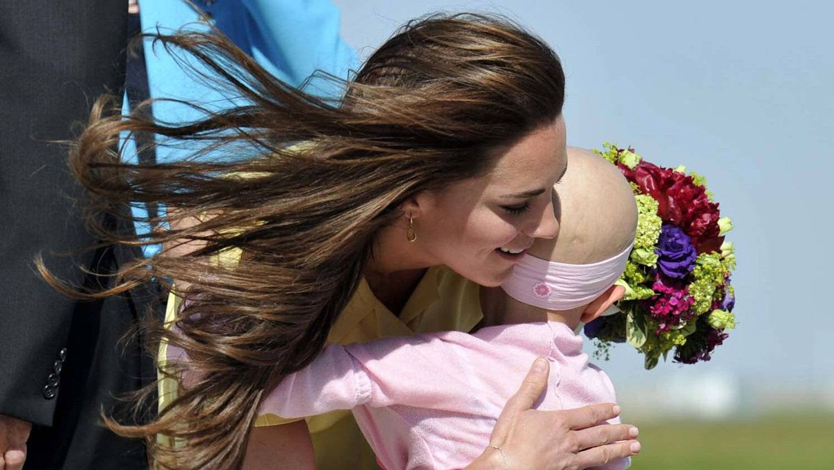 Catherine, Duchess of Cambridge, hugs 6-year-old Diamond Marshall as she arrives in Calgary, Alberta with her husband Prince William July 7, 2011.