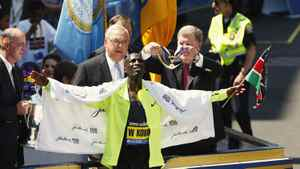 Wesley Korir reacts as he gets his medal after winning the men's division of the 116th Boston Marathon in Boston, Massachusetts April 16, 2012.