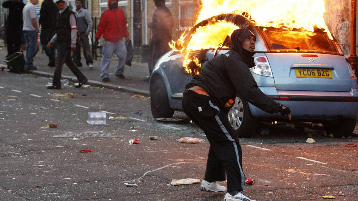 A rioter throws a rock at riot police in Clarence Road in Hackney on August 8, 2011 in London, England.
