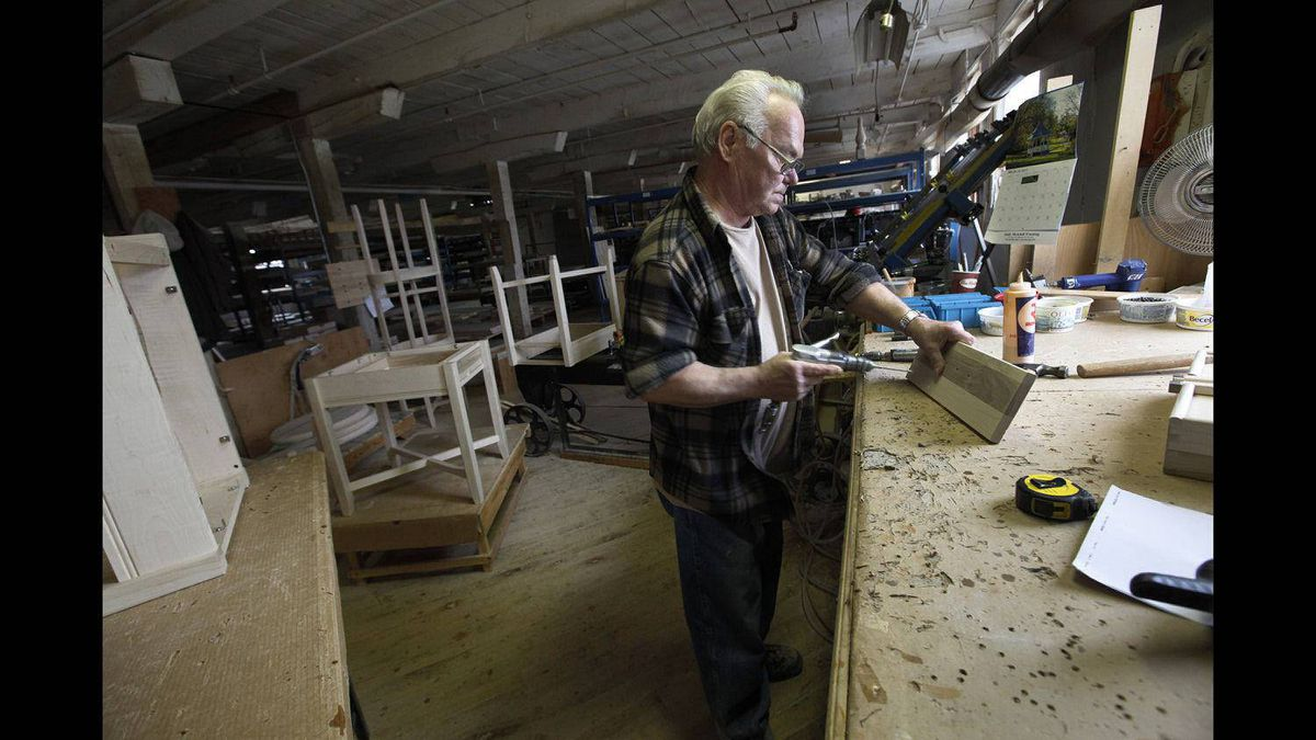 BG Furniture 30 year employee, cabinet maker Doug Schaus, works at the company's wood furniture factory in Walkerton, Ont.