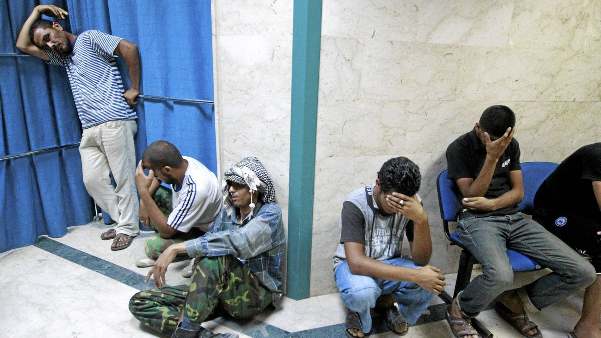 Libyan rebel fighters mourn comrades killed during clashes with forces loyal to Muammar Gaddafi at a hospital in Misrata July 11, 2011.