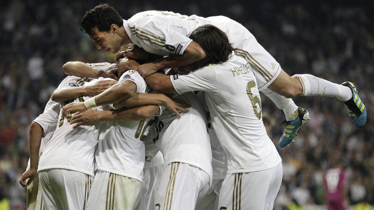 Real Madrid players celebrate a goal by Mesut Ozil against Lyon on Tuesday.