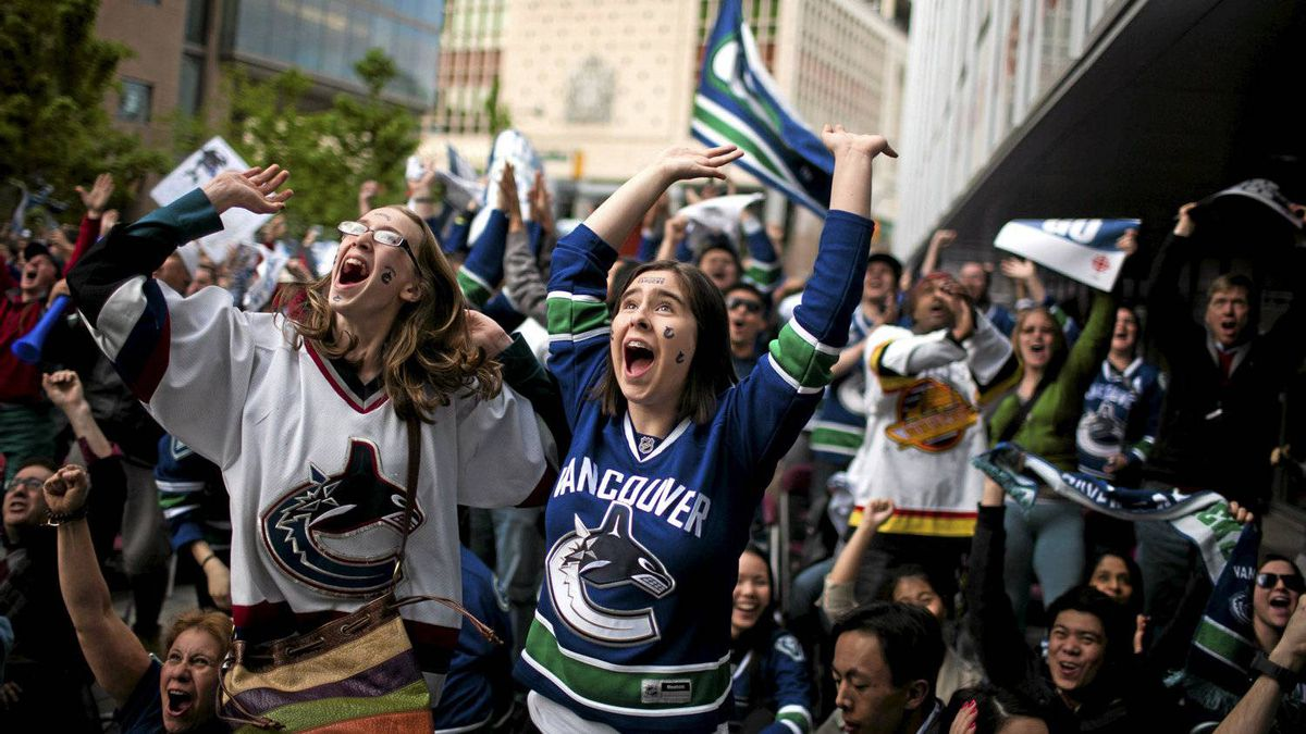 Vancouver Canucks fans react at CBC plaza to the first goal in the first period by the Canucks during Game 5 of the NHL Western Conference Final against the San Jose Sharks in Vancouver, Tuesday, May 24, 2011.