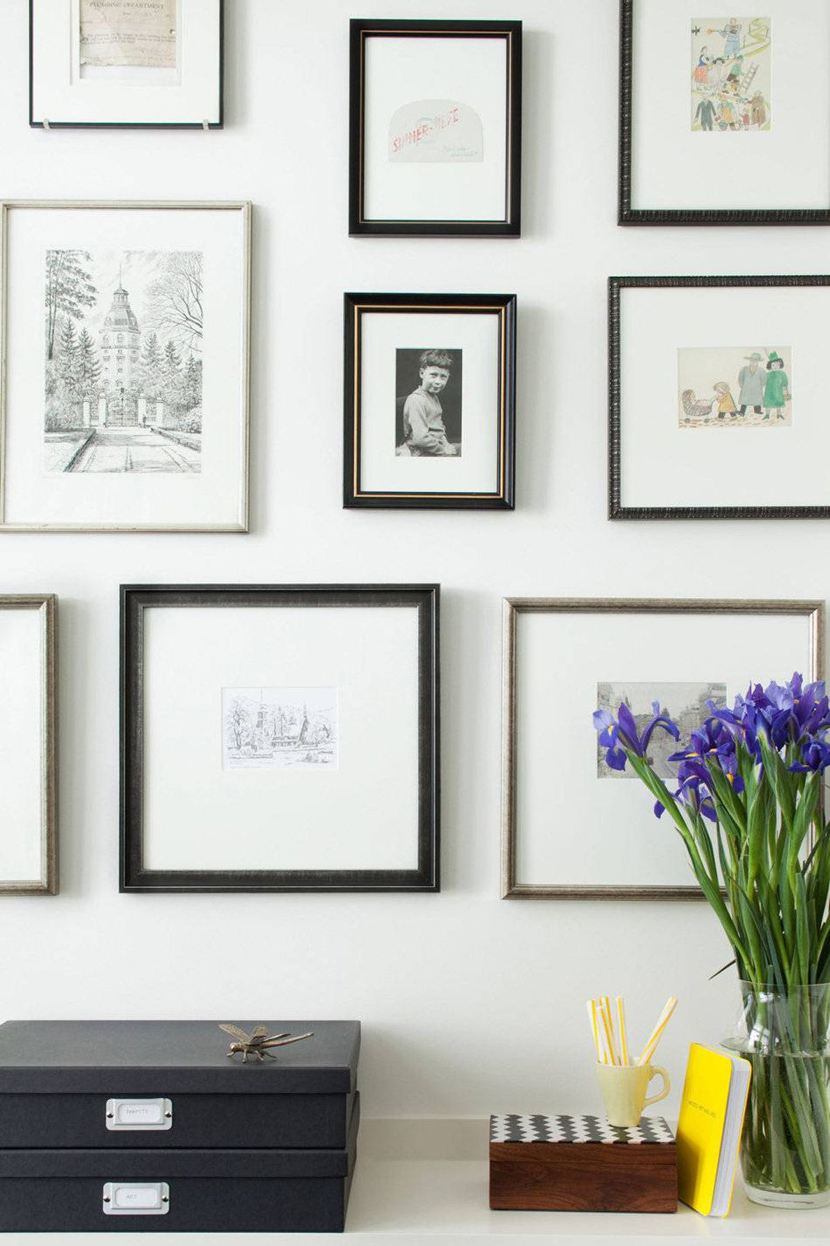 Artworks grouped on a wall draw you into the space.
