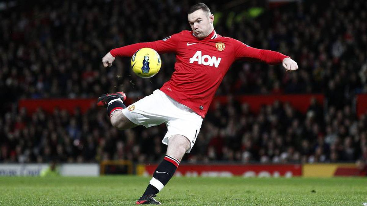 Manchester United's Wayne Rooney lines up a shot during his team's 's English Premier League soccer match against Wigan at Old Trafford Stadium, Manchester, England, Monday Dec. 26, 2011.