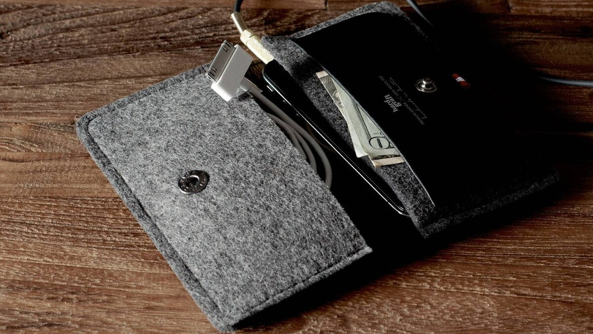 Hardgraft Heritage iPhone wallet The European styling of these beautiful wallets is only one reason they're so perfect as a gift. Crafted from the finest leather and wool felt, they are also very functional, providing pockets for up to eight cards and cash, and with a separate compartment for an iPhone. (US$95; hardgraft.com)
