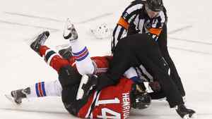 New York Rangers' Ryan McDonagh and New Jersey Devils' Adam Henrique (14) fight during the first period in Game 4 of their NHL Eastern Conference Final hockey playoff game in Newark, New Jersey May 21, 2012. REUTERS/Adam Hunger