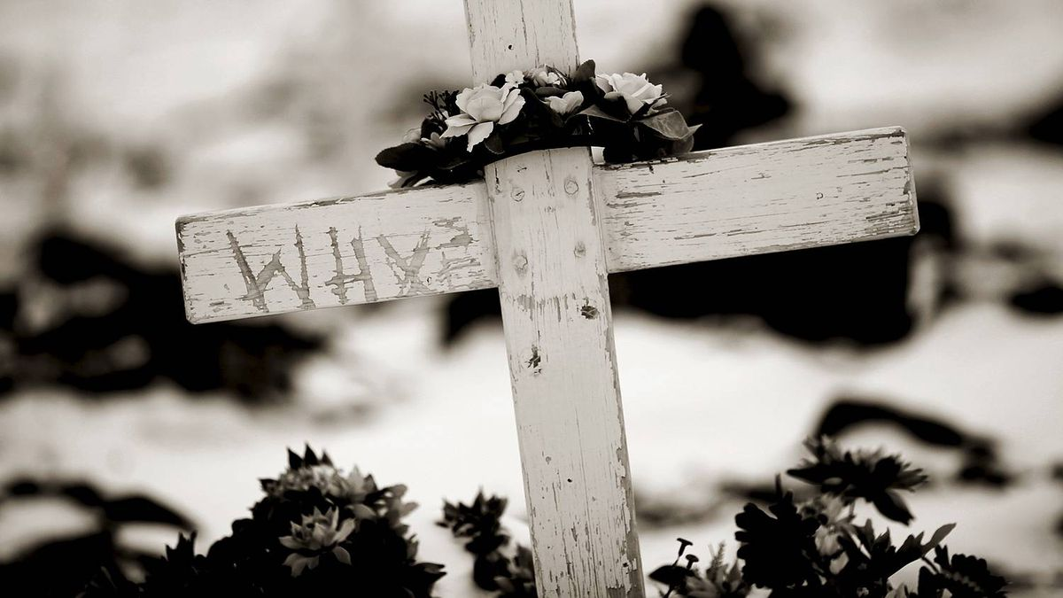 "A single word ""why"" is scratched into a wooden cross that marks a shallow grave in the Anglican Cemetery in Cape Dorset, Nunavut. The rates of suicide and violence in Canada's newest territory are far beyond those experienced anywhere else in the country."