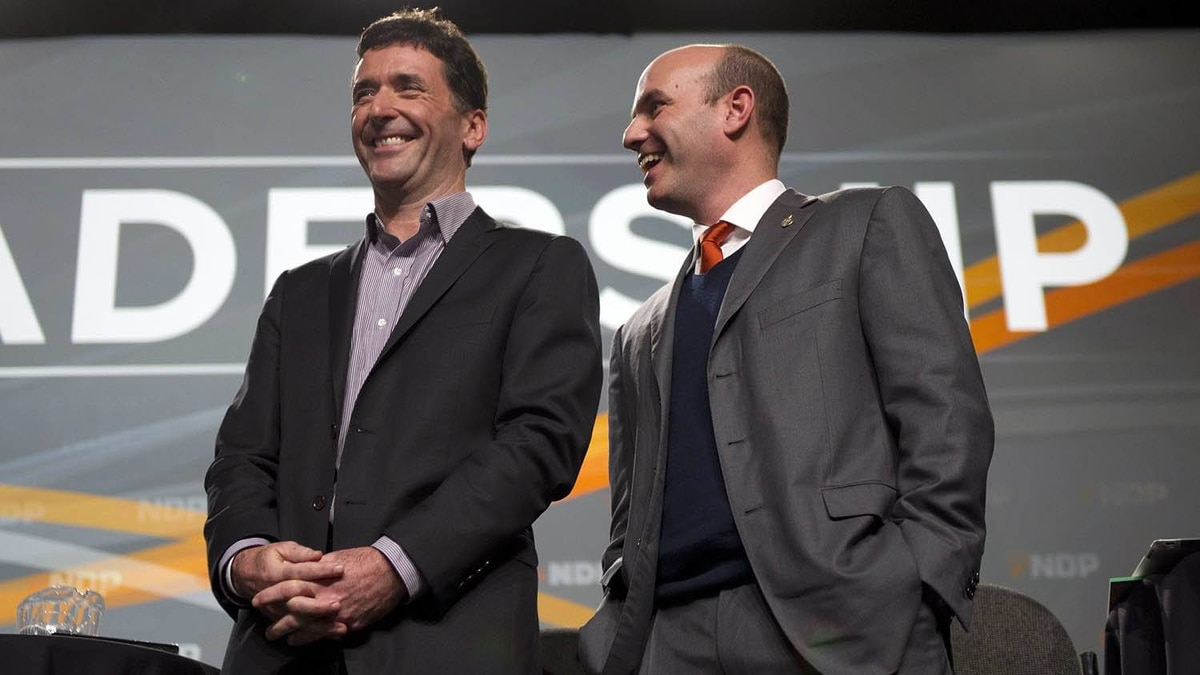 Federal NDP leadership candidates Paul Dewar, left, and Nathan Cullen talk before a town hall in Vancouver on Dec. 10, 2011.