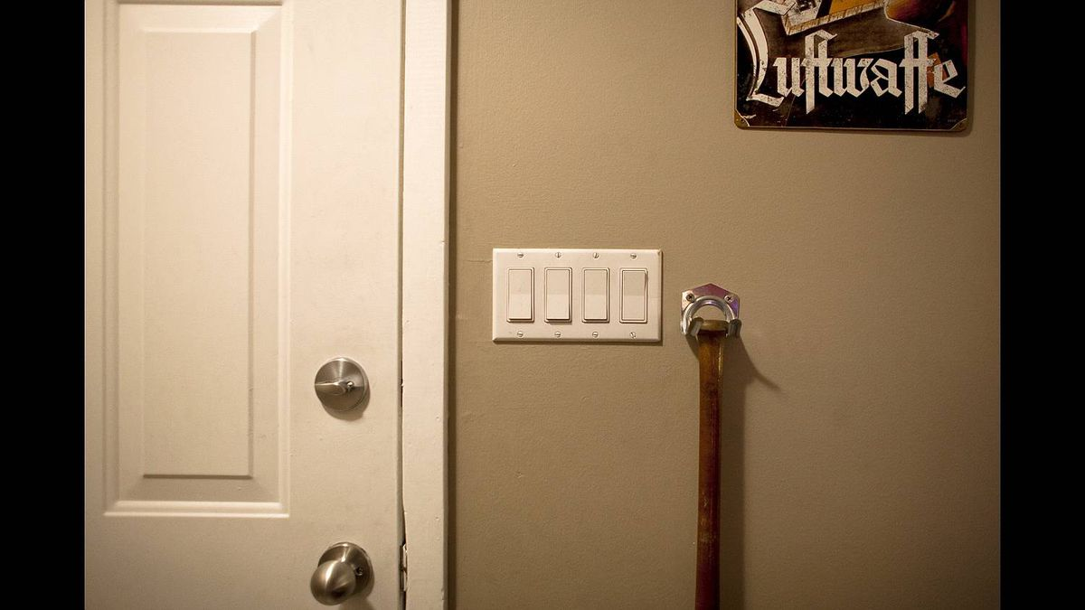 "A baseball bat hangs by the door of Kyle McKee's Calgary home. ""You don't play baseball?"" he asks, grinning."