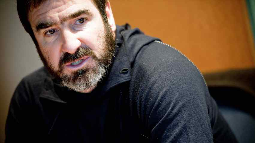 """Former footballer turned actor Frenchman Eric Cantona poses in Paris on December 8, 2009 during the launch of Cantona's photo book """"Elle, Lui et les autres"""" (Her, Him and the Others) created in collaboration with the Abbe Pierre Foundation, an assosiaction that champions the cause of the homeless and vulnerable."""