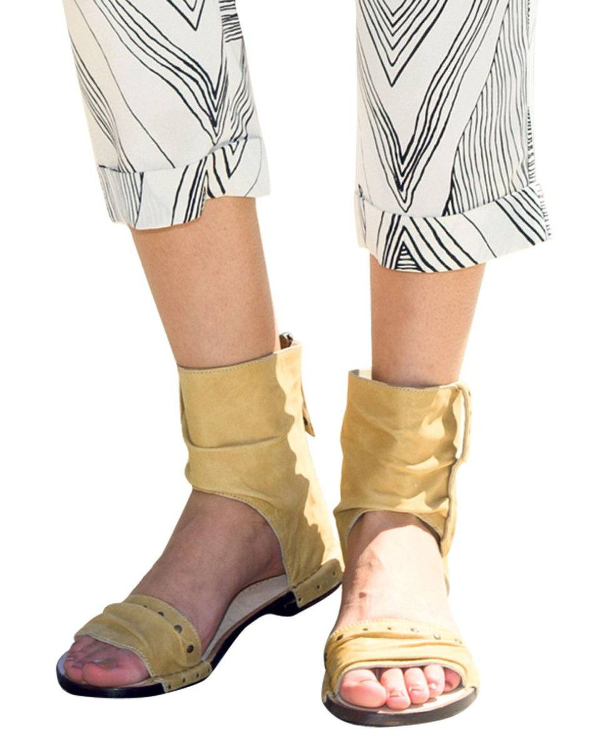 These breathable boots were made for walking. Bernardo sandal boots, $250 at Ron White. BCBGMAXAZRIA pants, $110.
