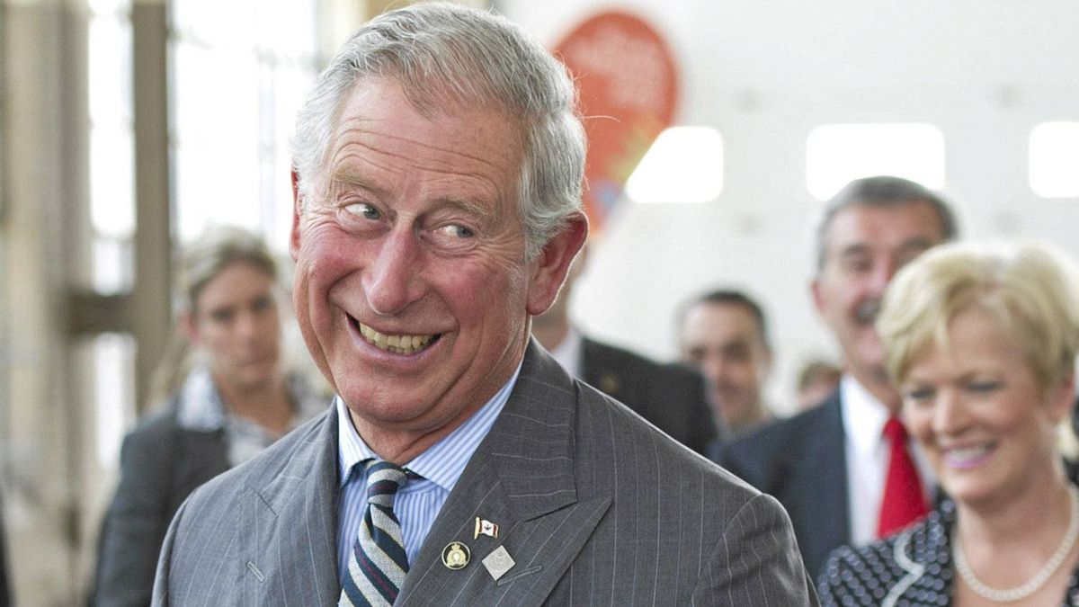 Prince Charles reactes after being aced while playing badminton while touring the future site Pan/Parapan American Games Athlete's Village in Toronto on Tuesday, May 22, 2012. The royal couple are on a four-day visit to Canada to mark the Queen's Diamond Jubilee.