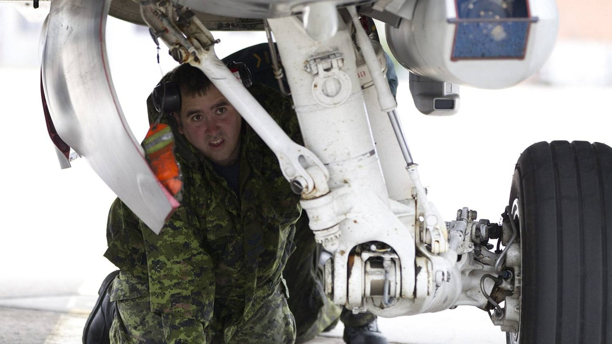 MCpl Robert Olivier inspects a CF-18 at CFB Cold Lake.