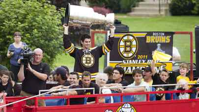 Adam McQuaid hoists the Stanley Cup as he travels on the Harbour Hippo to the APM Centre in Cornwall Sunday August 28, 2011.